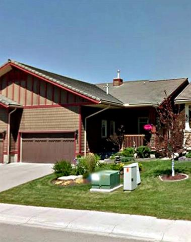 Open House Sunday Mar 11, 2018 12:pm till 2:PM**Former show home*** BEST  PRICE IN AREA.  Approximately 2500 Sq Ft of living Space** Main floor boasts open living and dining room, cozy gas f/p, french door to deck and stone patio. Walk in pantry, maple cabinetry, china cabinet, bright nook area to enjoy your mornings. Living space features gorgeous hardwood, tile flooring with carpet in the bedroom. Conveniently located main floor laundry. Large master bedroom with massive ensuite, soaker tub large enough for 2 and separate shower. Not to mention, a low maintenance lifestyle with NO CONDO FEES, HOA fee includes landscaping and no snow removal!  ?Basement with large family area with 2nd fire place and CUSTOM wet bar ready to entertain family and friends. 2 additional bedrooms  +3 piece bathroom?. Sellers decided not have carpet in one of the bedroom as it is being used as crafts/ hobby room.