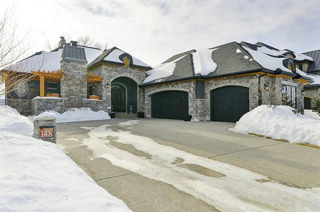 Welcome home to this EXCEPTIONAL & EXQUISITE private RIVERFRONT RETREAT nestled in the perfect community of Cranston.This ELEGANT & CUSTOM designed EXECUTIVE BUNGALOW was built for only the most discerning of buyer & for entertaining & is perfectly positioned backing the BOW RIVER w/incredible views.As you enter this magnificent home you are greeted into a grand foyer w/central custom staircase,gracious great rm w/vaulted ceilings,expansive gourmet kitchen w/professional appliances,sophisticated dining rm,massive grand master suite w/exceptional custom features,w/in closet w/built ins & a spa like ensuite.The lower level boasts a  great rm,family rm,expansive bar,wine cellar,2 bedrooms & oversized storage rm.On the exterior you will find a FRONT private courtyard complete with pergola & fireplace & off the kitchen a screened (power)covered patio,built in BBQ & deck with stairs to the magnificently LANDSCAPED YARD w/ pond & steps to the river. Triple heated o/s garage,AC & infloor slab heat & so much more.