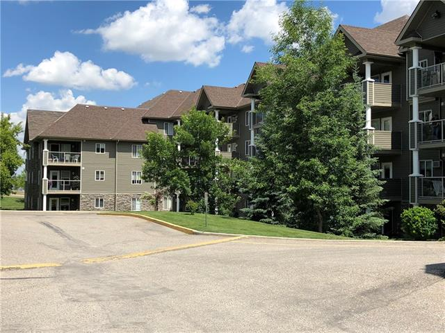 Amazing 2 bedroom suite in the coveted Legacy Estates in Millrise. This is a 60+ residence and building. An awesome dinner meal plan is available (approx $17 per person) and is prepared by a chef and served 5 nights a week in the dining hall.  This ground floor unit faces east and has an enclosed secure sunroom for your pleasure instead of a deck or patio. Added updated features of this condo are newer cork floors in the bedrooms, new granite countertops throughout, new sinks, new built in dishwasher and laminate flooring as well as blinds. The master bedroom offers its own ensuite bathroom with a soaker tub and shower plus a walk in closet. The main living area is bright and cheery and is very roomy. Special about this unit is also the added benefit of a titled storage locker as well as 1 titled indoor heated parking stall. The complex itself offers a library, gym, games room, social room, roof top outdoor deck, Craft room, and a hair salon. The heated underground parking has a wash bay! Great Value!
