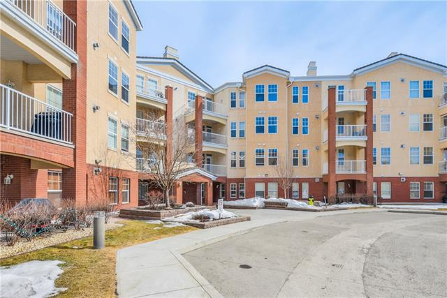 LOCATION, LOCATION, LOCATION! Stunning panoramic views, picturesque mountains (to the west) and downtown (to the north);. Fish Creek Provincial Park is just steps away where you can enjoy walking/cycling. Close to Fish Creek LRT station and shopping. This professionally renovated end unit features 2 bedrooms, 2 bathrooms (plus den), with wrap-around balcony with BBQ gas outlet in the heart of Shawnee Slopes. This property will impress your senses from the moment you enter the spacious living space with 9? ceilings, angled hardwood and slate floors throughout. You will feel like you are HOME. This 1,290 sq. ft. home has an open floor plan incorporating a fabulous living room that has a stunning floor to ceiling stone and gas fireplace, a dining room where you will be proud to have guests for dinner. There is a den with translucent glass French doors, in-suite laundry room, 2nd bedroom and bathroom for guests and the main foyer with a large coat closet.   MORE INFO BELOW VVV