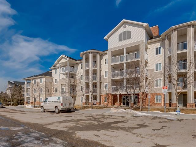 Terrific, well maintained 2-bedroom corner unit close to all the amenities you would need - grocery stores, banks, VIVO rec centre, Landmark Cinemas, walking paths, Country Village Lake and access to Deerfoot and Stoney Trail! Large and open living space is great for entertaining friends and family seamlessly between the living room with gas fireplace, kitchen and dining area. Your oversized walk-out patio is at the quiet end of the complex, and with only 1 shared wall you've got privacy, both inside and out. This unit also features insuite laundry, storage, and a secure heated underground parking stall. Condo fees include all utilities, so your monthly payments are less than renting. New laminate and tile flooring as well as a new toilet and dryer! Just move in and make this place your own!