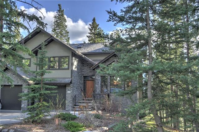 Soaring mountain views and a spectacular south-west exposure create a grand mountain retreat on the 8th hole of the iconic Silvertip Golf Course. Positioned high above Canmore and the Bow Valley, enjoy a peaceful and quiet surrounding while accessing both Town and resort amenities. The master retreat is a half flight of stairs up from the main living space with a spa inspired ensuite which includes a soaker tub and sauna. Two of the five additional bedrooms are on this level and are ideal for both children and guests. With three living spaces, the open great room, kitchen and dining room are warmed by the wood burning fireplace and lead out to the spacious upper balcony. The upper loft is a tranquil retreat with mountain views and a place gather. The lower family room includes a wet bar and view that rivals the main floor along with walkout access to the yard. An inviting home with meticulous craftsmanship that embodies its mountain locale.