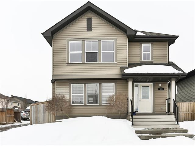 This well maintained home is gently lived in & shows as almost new. It is conveniently located across from the school with easy access out of the community. As you drive up you will fall in love with the curb appeal including the wide front steps. As you enter you will notice the hardwood flows through the majority of the main level. This home has an open concept with a large living room featuring a fireplace with mantel & huge windows. The kitchen has a newer microwave & dishwasher & there is an island with raised breakfast bar. The dining area will handle your large table & has views of your pretty backyard with a great deck. There is an oversized 22x24 ft garage & still plenty of yard for the kids & puppies. Upstairs has a full bath, 3 large bedrooms, including a master with a great walk-in closet & a 4 pc ensuite. The basement is newly developed with a gorgeous full bath & a great room with large windows. The front load washer & dryer are included & neatly tucked away. This beauty will not last long.