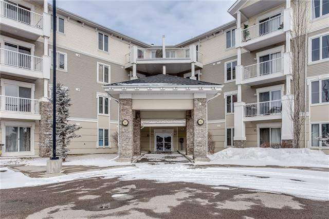 This one truly feels like home. Impressive large corner unit that beautifully fills with warming natural light throughout. Stylish open plan layout with laminate and tile flooring, open kitchen with breakfast bar, corner fireplace and patio doors that lead to a large sunny balcony. This spacious condo offers 2 bedrooms, 2 full baths, in suite laundry, storage locker right out your front door and 1 assigned parking stall. Conveniently located, close to SaddleTown Crossing, schools and numerous amenities.