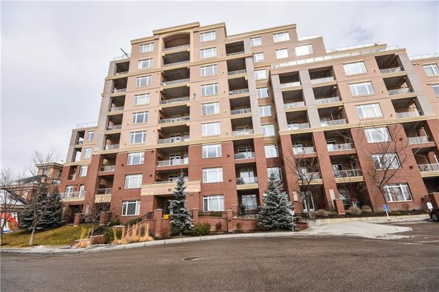 Exceptional ground level apartment with over 700sqft of living space and 10' ceilings in the desirable community of Spruce Cliff! Your new home welcomes you into the spacious foyer. The living room boasts a corner fireplace and plenty of space to entertain. The kitchen features a raised breakfast bar, granite counter tops, SS appliances and ample cupboard space. Your spacious master suite has a walk-in closet and private access to the main 4p bath. A laundry/storage room completes this wonderful unit. Outside you have a private and secured balcony over looking a quiet walking path. This unit also has 1 titled parking stall! This building is loaded with amenities including a fully equipped gym and access to a large quiet green space. Steps away from a golf course, easy access to the C-Train station, and close to schools & shopping. Don't miss out on all this home has to offer, book your showing today!
