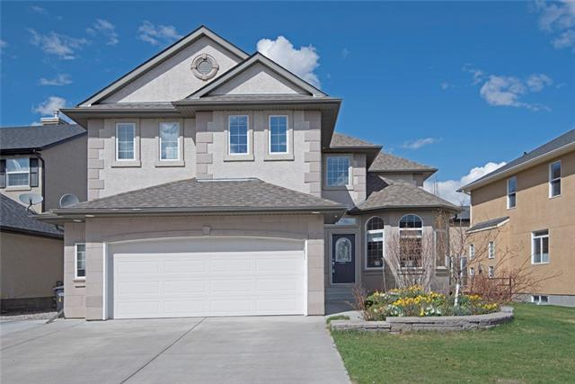 COME VIEW THE 3D TOUR of this air conditioned former showhome, in a quiet cul-de-sac, set among million dollar homes & offering superb views of Crystal Shores lake! The grand entrance has hardwood flooring & tile inlays & the fabulous den has built ins, a bay window & a 10 ft ceiling. The open to above living room has a feature fireplace & a wall of windows to accentuate the views. The dining nook is adjacent to the huge kitchen, which has long runs of countertops, a custom hood fan, storage galore, two tone cabinetry & a walk through pantry. Upstairs benefits from a loft, a master retreat & 5 pc en-suite, with a bench overlooking the lake, a laundry room, 2 great child bedrooms & a 4 pc bathroom. The professionally finished basement offers a 4th bedroom, bathroom, family room & recreation space. Out front, there?s an extended width driveway & a huge planted border that is stunning in bloom. Enjoy the lake views out back, on the huge deck, with its side privacy panels, or in the fully landscaped yard.