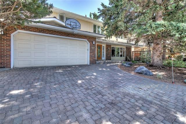 Renovated 5 bedroom executive family home located on a quiet cul-de-sac in the heart of Bayview, this 2840 sq ft ultra bright 2 storey offers a mature treed yard, newer kitchen, bathrooms, flooring, windows, furnaces, roof shingles, eavestrough & driveway. Offering a functional layout the large formal living with picture window & wood burning fireplace opens to the dining room overlooking the treed yard. The tasteful maple kitchen has granite counters, large island with eating bar, great family room with wood burning fireplace & massive windows overlooking the garden, spacious laundry with yard access & an oversized double attached garage. 5 large bedrooms including a spacious master with walk-in closet & three piece ensuite. The lower level has family and games rooms, powder room, massive storage and workshop . Moments to the Glenmore Resevoir, Weaslehead, pathways, Rockyview Hospital, Glenmore Landing, Jewish Center, all levels of schooling, shopping, transportation and city center access.