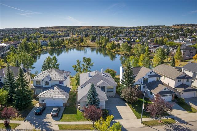 GORGEOUS WALKOUT BUNGALOW w/OVER 2775 sqft, backing DIRECTLY onto a LARGE POND w/VIEWS of NOSE HILL PARK + features a TRANQUIL, Prof Landscaped SOUTH BACKYARD, NEWER (2016) ROOF + O/S TRIPLE GARAGE!!! BRIGHT + FRESHLY PAINTED throughout w/SKYLIGHTS, 9? CEILINGS on main + lower, WELCOMING Foyer open to a STUNNING front DINING rm accented by COLUMNS, BIG Windows + LIGHT HARDWOOD Flrs, LRG Living rm w/ w/3-WAY GAS FIREPLACE + AMAZING VIEWS, CLEAN Kitchen w/ALL WHITE CABINETRY, Central SKYLIGHT, BIG Corner PANTRY, ISLAND w/ B-fast Bar, Breakfast NOOK w/Sliding Door ACCESS to the BALCONY, Separate MUD rm, 4 pc bath, 2 Bedrooms on the main including the MASTER w/W.I.C. + LRG 4pc EN-SUITE w/JET TUB!! The WALK-OUT Lower level features IN FLOOR HEAT, 2 additional BEDROOMS, a 4pc bathroom, LARGE Laundry/Utility rm w/NEW H20 Tank + a MASSIVE FAMILY rm w/GAS F/P + FRENCH DOORS to SENSATIONAL PATIO + YARD w/JAPANESE ROCK GARDEN, GREENERY + TREES, POND w/BRIDGE + UNIQUE views + access to POND! DON'T MISS YOUR CHANCE!!!