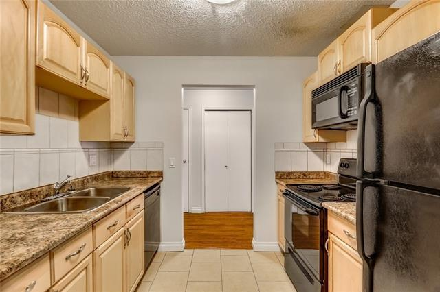 Fantastic opportunity to own in a great location! This bright, open 2 bedroom unit is on the top floor and offers convenient access to all amenities, public transit, the University and COP/Winsport. Updated flooring throughout, new carpet, fresh paint, 4 pc bath, in-suite laundry, private balcony and more. Move in ready! Don't miss out! This is perfect for a first time home buyer or investment.