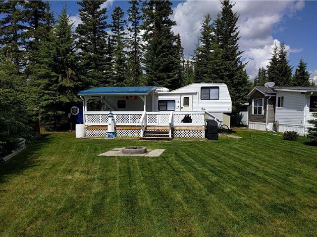 A wonderful recreational property located within Sundre Riverside RV Park. This beautifully developed lot is nestled in the corner of a loop with a picturesque view of a protected creek behind the property therefore there will never be backyard neighbors. With a front yard landscaped with grass it is very flexible for activities as well as for setting up tents or even pulling other trailers onto the lot to spend relaxing weekends with your family or friends. A recently rebuilt deck with new decking and railing is over 250 square feet with a large roof. Other external features include, 3 vehicle parking space, a large wood shed, a couples swing, a fire pit, new BBQ, dartboard, deck roof lighting, patio furniture, storage shed. The 29.5 foot 5th wheel trailer included, has been well maintained to ensure all facilities are in perfect working order.