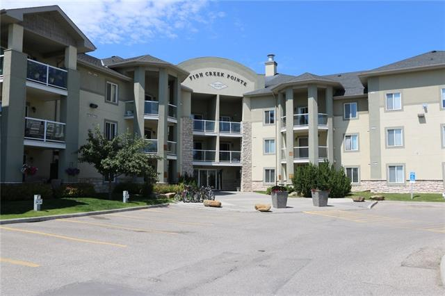 """No walking through the whole building to get into your condo, convenient main floor access makes it easier to get into your unit.. think, your groceries can be carried through the patio door instead of all the way down the hallway. Is there 2 of you? this unit has 2 parking stalls 19 and 36 plus lots of free visitor parking. Great location with fish creek just behind. CONDO FEES INCLUDE HEAT AND POWER, Water & Sewer. Newer laminate floors and recently finished master bath tub. Special assessment on the building coming. Seller willing to add this to the price to assist buyer with purchase, so the buyer can include this in their mortgage. To see a movie with listing details click on the multimedia link or search """" fishcreek Calgary condo"""" on the most popular video website."""