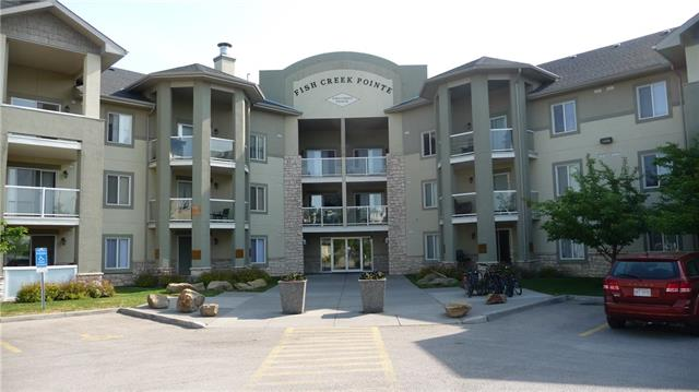 One of the best locations! Huge 2 Bedroom, 2 Bath main floor corner unit overlooking Fish Creek Park! You will love the oversized private patio - relax and enjoy nature & the wild life! Spacious open concept floor plan with a Huge Living Room with attractive gas fireplace (glass door to patio). Large Kitchen with lots of special drawers & organizers - Breakfast bar and large Dining Area! Quality Appliances are included! Master Bedroom features a walk-through closet to Ensuite (double shower), Second Bedroom also over looks Fish Creek Park. In the Suite Laundry plus a separate multi-purpose Room - currently used as storage but suitable for a Computer Room.  Immaculate Condition - Pride of Ownership! Secure underground Titled Parking with large storage room. Excellent location - close to many amenities! Flexible Possession. Condo Fee includes all utilities (Electricity, Heat & Water).