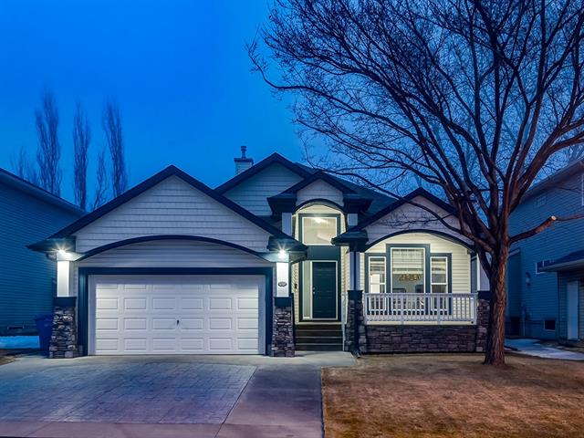 Spacious BUNGALOW located on a HUGE 588 sq mt lot, ACROSS from CHESTERMERE LAKE + w/OVER 2448 sq ft of developed living space incl a FINISHED Basement! Enjoy AMAZING feature like: BIG COVERED PATIO, NEWER ROOF (2017), LANDSCAPED YARD w/SHED, FIRE PIT + UNDERGROUND SPRINKLERS, FRONT+ BACK Gas line, VAULTED CEILINGS, NEW APPLIANCES, FRESH PAINT + MORE! Welcoming Foyer w/GORGEOUS central WOOD + METAL railed stairs, Vaulted ceilings, Hardwood flrs, Living rm w/WOOD BURNING F/P + Stone Tile B-splash, L-SHAPED Kitchen w/MAPLE CABINETRY, ISLAND w/B-FAST BAR, PENDANT LIGHTS, NEW S.S. Appl's, Dining rm w/HUGE window + access to SPACIOUS yard + deck w/BUILT-IN BBQ w/stone work, GLASS panels + lower Patio! Main also has a 4pc FAMILY bath + 3 BDRM's incl the MASTER w/4pc EN SUITE w/NEW TILE + BIG W.I.C! LOWER has a HUGE REC RM, T-BAR Ceiling, STORAGE + BIG Laundry/Utility, a LARGE 4th BEDROOM w/NEW LAMINATE FLR''s + private 4pc EN SUITE, PLUS a FAMILY RM w/Tiled Gas F/P! CLOSE to PARKS, PATHWAYS, SCHOOLS + the LAKE!