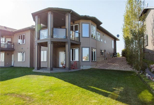 VERY MOTIVATED SELLERS!!!Escape from the City & enjoy Speargrass Links Style Golf Course Community, with beautiful homes and villas nestled along the Bow river! This amazing Community has detached and attached homes that are totally upgraded, with walkouts lots either with natural reserve land that looks onto golf course or directly backs to the golf course! This fully developed Villa backs to the 12th hole and fronts a quiet street with park! Enter the amazing foyer and you will be impressed with the open floor plan! A bedroom/office allows for home run business if needed, main floor laundry for convenience, and a full bath! Onto the kitchen with granite counter corner pantry, large island, and stunning cabinets. A Great room with corner fireplace & doors to the top deck! The master bedroom has a large en-suite with lovely walk-in-closet. Down to the bright and spacious walkout  you have a large family & games room, 2 bedrooms, a full bath & storage. See additional remarks....