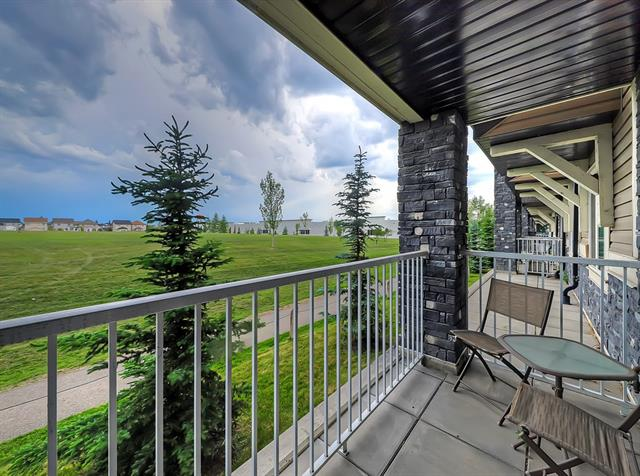 """Best location in the complex!! Immaculate quiet one bedroom main floor condo perfectly located overlooking a greenspace in Cardels ?Prestwick Place? features numerous upgrades though-out and a designer color palette. The ideal floor plan gives you plenty of useable space with an open concept design connecting the u-shaped kitchen offering crisp white cabinetry, stainless steel appliances and built-in over the range microwave, an adjoining dining area, a spacious bright living room & sliding patio doors entering onto a West facing balcony with a gas hook up for BBQ season to enjoy the mountain views on clear days.  The master bedroom features ample space with a perfect walk-through closet into the 4 pc cheater ensuite with access to the bathroom from the foyer, great for your guests. Convenient in-suite laundry. Condo includes a titled parking stall with winter plug-in & assigned storage unit. Well managed complex with low condo fees. Located close to shops and transportation. This condo is a """"must see"""""""