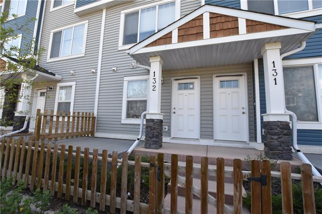 **SELLER IS MOTIVATED - $7,000 PRICE REDUCTION SINCE LISTING - LET'S WORK A DEAL TODAY **. Welcome to this FORMER SHOWHOME Townhouse in the great Community of Ravenswood. This three storey Townhouse has a 23'L garage for a large vehicle and for storages. The Main entry has a Large Foyer, a Front Room that is perfect for an Office as there are great windows for light, and has a half bath nearby. The Main Upper Level Features a Spacious Kitchen with Modern Styling, a Large Dining area and Living Room. The Upper level has 2 Spacious Bedrooms, a Full Bath, and Upper Laundry. This home has a private patio to enjoy the morning sun, and a deck off of the kitchen. Close to new schools, shopping and amenities. Call for your personal viewing today.