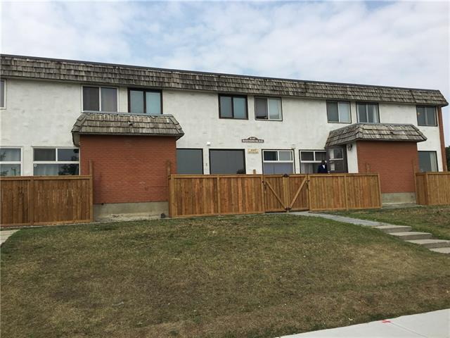 Why do you pay rent? Affordable Bright and cozy 2-bedroom townhouse convenient located just beside Centre Street. Brand new fence and deck built for each unit has its deck and private yard. Newer windows, doors, laminate floor, full bathroom, stove, kitchen faucet even more.  This bright, quiet and cozy 2 bedroom townhome is in a complex of 8 units. The roof of a 30 year high quality SOPREMA TORCH-ON installed in 2011. It is centrally located, only one block west of Centre Street and one block south of the Simons Valley Mall. Walk distance to shopping, library, swimming pool and schools. Walking distance to John G. Diefenbaker high school which is one of the top schools. Steps away to public transportation and minutes to downtown and easy freeway access.  The full basement is developed and on an open site. Great value--ground level patio and parking stall! Tenants may stay. This unit faces east which is cool in summer. Great Value for first home buyers and investors.