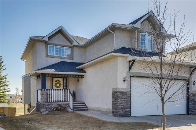 OPEN HOUSE: May 19th 12-2pm & May 20th 2:00-4:30pm. This home has all the qualities of a perfect location! Quiet cul de sac, backs onto greenspace, playground & walking path, walkout basement, a sunny south facing backyard on a pie shaped lot & a quick walk to the lake, school and shops. The main floor has an open concept with hardwood floors, stainless steel appliances, granite counters, kitchen island for added counter space, living room gas fireplace & a renovated powder room with a rich walnut vanity capped with stylish granite. Upstairs there's a bright bonus room with skylight, a renovated 4 piece bath & 3 spacious bedrooms including the master featuring a renovated ensuite with a deep soaker tub & tile surround shower with tempered glass door. The lower level has infloor heating, plenty of natural light & is complete with a 3rd full bathroom, rec room & plenty of storage. Step outside into the back yard from the basement or enjoy the sun on the low maintenance deck above with a retractable awning.