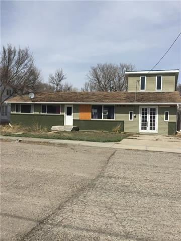 Good location on this large main floor area bungalow  with an added loft/ bedroom that has a nice balcony off this room, home needs some tlc, great lot!