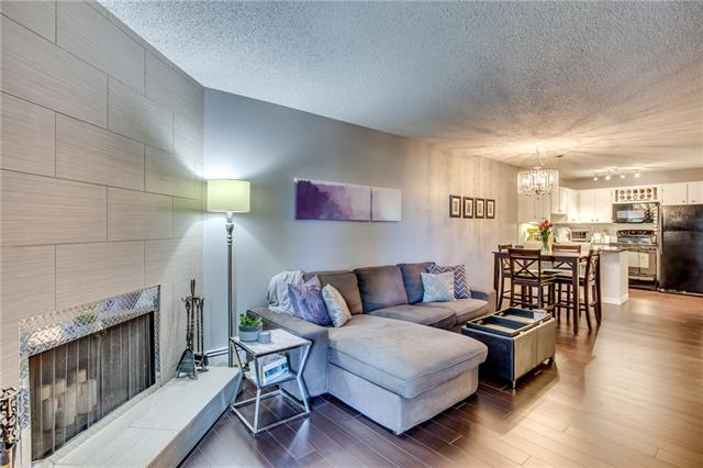 Welcome to this tastefully updated unit showing pride of ownership throughout. Offering 1,065 sq ft of living space, this condo offers plenty of room as well as in-suite laundry. Entire unit is finished with dark laminate flooring with ceramic tile in the bathrooms and laundry area. The large living room area provides ample space and is highlighted by a modern tiled fireplace. Hallway from the living room leads to 4-piece main bath & 2 great sized bedrooms, an excellent opportunity for a roommate or guest bedroom/office. Beautifully updated kitchen complete with grey quartz counters, plenty of cupboard space & good-sized pantry. Enjoy the summer months out on your 30-foot balcony surrounded by mature trees! Master bedroom offers a walk-through closet with built-in closet organizers & access to your own 2-piece ensuite. New washing machine (2017), dishwasher (2015) and new patio doors and windows (2014). Great location with immediate access to Elbow Drive, Glenmore Trail, Macleod Trail and Chinook Centre!