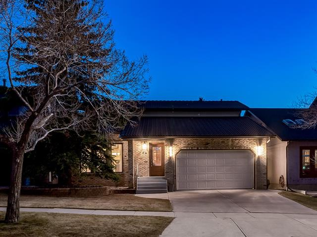WOW!!! BEAUTFULLY UPGRADED w/OVER 2746 SQ FT of IMMACULATE living space feat: A/C, CUSTOM Built-in's, TRIPLE PANE Windows, CROWN MOLDING, IN-FLOOR HEAT, RENO'd Bathrooms, INTERCOM, SURROUND SOUND, DEVELOPED Bsmt w/9' Ceilings, UNDERGROUND Sprinklers + MORE! STUNNING Foyer w/H-WOOD throughout, Living/Dining rm w/SOARING VAULTED CEILING, 2pc bath w/POCKET Door to OFFICE, FAMILY rm w/MODERN 2-WAY GAS F/P + BAY Window, Kitchen w/OAK CABINETS + under lighting, GRANITE counters + B-Splash, S.S. Appl's, GARBURATOR, SINK over the window + B-FAST NOOK w/access to HUGE Deck + GAS LINE to BBQ! WOOD RAILED Staircase to Upper w/RENO?d 3pc FAMILY bath + IN-FLOOR Heat, 3 Bdrm's incl the SUNNY MASTER w/BAY WINDOW, W.I.C w/Laundry + 5pc SPA-LIKE En suite w/MARBLE Vanity, GORGEOUS TILE, IN-FLOOR heat, STEAM SHWR + JET TUB! FULL BSMT w/LRG FAMILY rm, 4th BDRM, 3pc Bath, Storage + Utility rm w/NEW H20 tank + WORKSHOP w/GARAGE access. A WEST backyard w/TREX Deck, gas FIRE PIT, SHED, lots of MATURE Trees + Sprinkler system!!!