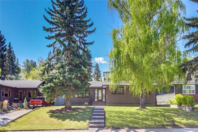 Welcome home to the prestigious community of Elboya! This stunning bungalow has been thoughtfully renovated to create a modern contemporary feel yet keep some of the original character. Inside features an open concept floor plan tying in the living room, kitchen perfectly. The gourmet kitchen oozes style & class with SS appliances, quartz countertops, hand painted tile backsplash, gold accents & plenty of cabinet & counter space. You will love the beautiful bathroom with a large soaker tub gorgeous flooring and custom cabinet. Rounding out the main level is 2 additional bedrooms with custom feature walls. The basement provides a full illegal mother-in-law suite, a large rec room, laundry, a 3 piece bath as well as a 4th bedroom.  Don't forget the south facing backyard which is private, and perfect for summer entertaining! The exterior has been fully updated from new windows, skylights, new stucco and concrete walkway surrounding the home. A great opportunity to get into this wonderful community.