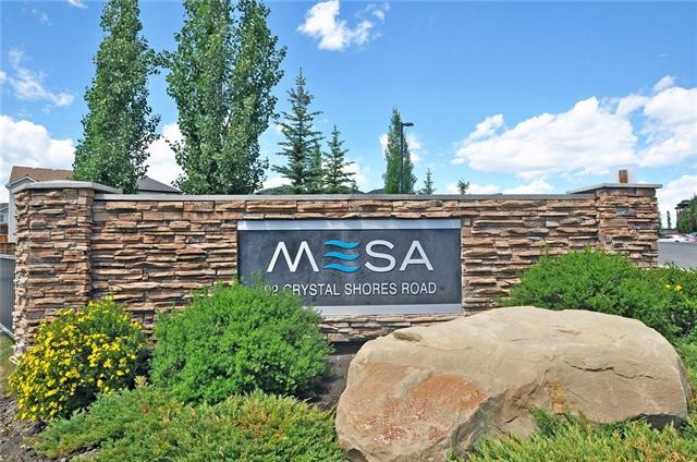 Fantastic Opportunity to own this exceptionally WELL MAINTAINED 1 Bedroom with LAKE ACCESS, MAIN FLOOR UNIT condo ideally located in the Mesa at Crystal Shore. Original Owner, Non-Smoking, & Low Condo Fees make this an ideal property for First Time Buyers & Investors. This LIGHT & BRIGHT Condo offers loads of Natural Sunlight throughout the Open Concept living area with Gas Fireplace leading to a Private Balcony ideal for BBQing. The Master Suite features a Walk-Thru Closet, & Spacious 4 Piece Bathroom. The kitchen showcases Stylish Tile, a Large Island & Breakfast Bar, Black Appliances & a designated Eating Area. The unit is also equipped with a small nook - designed to function perfectly as a Den or At-Home Office Space. Ownership in this complex also provides what many others do not: Access to the Amenities Center including an In-House Gym, Hot Tub, Sauna, & Private Room Rental. This condo also includes In-Suite Laundry, TITLED UNDERGROUND PARKING STALL, STORAGE UNIT & Lots of Visitor Parking.