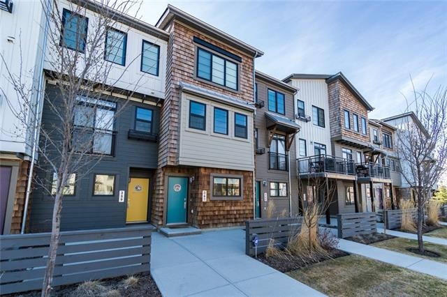This 3 storey modern town home located in the community of Walden is loaded with builder upgrades, such as the unique main floor den which maximizes the use of space?just one of the great features of this stunning property. The bright an open concept kitchen is fitted with thick stone countertops, and a stainless steel appliance package, all overlooking your private patio complete with gas line. The dinning room area is appointed with a modern black finished pendant lighting feature and opens onto the family room which is a perfect place to relax and enjoy the West facing evening sun. Upstairs the functional floor plan continues with 2 master bedrooms each having their own private ensuite bath, as well an upgraded washer and dryer complete this floor. Tons of parking right out front of your door step along with an attached garage plus driveway for a second car, contemporary colour scheme, great location close to parks and amenities, and so much more! Call today to book your private tour!