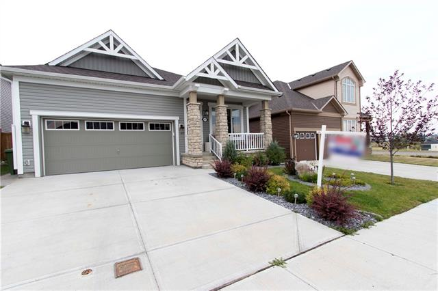 Dreaming of that perfect bungalow?  Take a look at this great bungalow with views of  Chestermere Lake from the front veranda and the rear deck.  Just a short walk from the $2 million public beach in the Cove your family will love the new beach and playgrounds there.  This 1,555 sq. ft. bungalow has 9 foot ceilings,  2 bedrooms up, a den, laundry, dining room, exceptional kitchen and a great room with fireplace.   The dark stained barn board hardwood floors are beautiful and are set off with white trim.  The cabinetry is a dark shaker style.  The counter tops are a beautiful light granite set off with under-counter lighting.  The kitchen has incredible stainless-steel appliances.  The appliance package was an additional 11,000 over and above the house price.  The yard has been landscaped to be worry-free with underground sprinkler and automatically watered flower beds & pots.