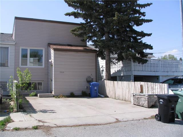 Amazing opportunity for the handy-person. Three bedroom attached home with NO CONDO fees. Parking pad for two cars plus a west backing rear fenced yard. Kitchen has been updated in the past, and a new furnace has just been installed. Quiet street close to all amenities.