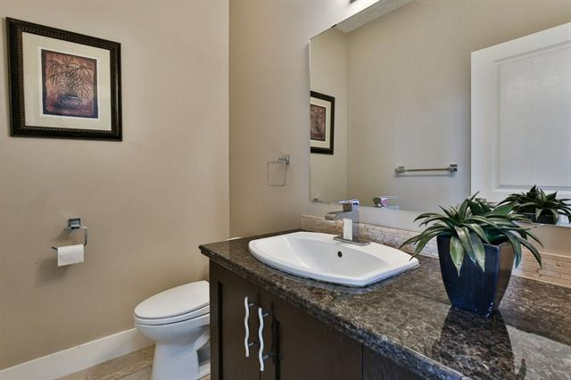 Nice size 2 pce main floor bath has granite countertops and ceramic tile flooring.