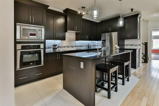 Kitchen is open to great room, has lots of cabinets and drawers for storage, granite counter tops, stainless steel appliances , built in ovens, built in dishwasher, beverage cooler and fridge.