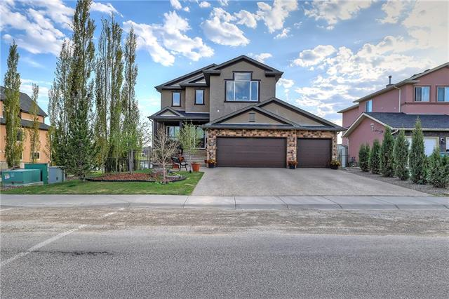 Experience executive luxury  living at  its finest in this amazing home, located in the desirable community of  Rainbow Falls of Chestermere! Fully developed & stunningly appointed, showhome quality presents itself to  you  the minute you walk in the door; soaring ceilings & expansive windows grace a great room warmed by a  fireplace, while the gourmet kitchen boasts granite counters, a walk-through pantry, and elite stainless steel  appliances. The breakfast nook is large enough for entertaining, while a flexible den makes  for  ideal home  office space! The upper bonus room is a delight, while the master is truly a retreat, large, with western views,  and a spa  ensuite! The walkout level has been masterfully developed into a games/media/rec  room with  a  beautiful  wet  bar,  and  this level  houses  another  bedroom  and  full  bath  as  well! Step out to a backyard  oasis,  backing  to  the  largest  pond  Rainbow  Falls  has  to  offer!  Truly  a  must - experience  home  -call  today