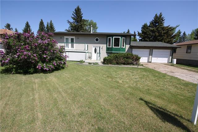 BEAUTIFUL BI-LEVEL LOCATED IN THE TOWN OF BEISEKER, ALBERTA. FEATURING NEW WINDOWS, NEW ROOF, NEW SIDING, THREE BEDROOMS ON THE MAIN FLOOR,MASTER WITH THREE PIECE ENSUITE, LARGE LIVING ROOM, SPACIOUS KITCHEN WITH BREAKFAST NOOK/ DINING AREA OPENING FRENCH DOORS TO A LARGE DECK AND HUGE YARD. DOUBLE ATTACHED GARAGE. BASEMENT IS FULLY FINISHEDWITH A HUGE FAMILY ROOM A BEDROOM AND ANOTHER FULL BATHROOM. NEEDS SOME TLC INSIDE BUT A BEAUTIFUL HOME FOR COUNTRY LIVING. CALL FOR YOUR PRIVATE SHOWING TODAY!!!