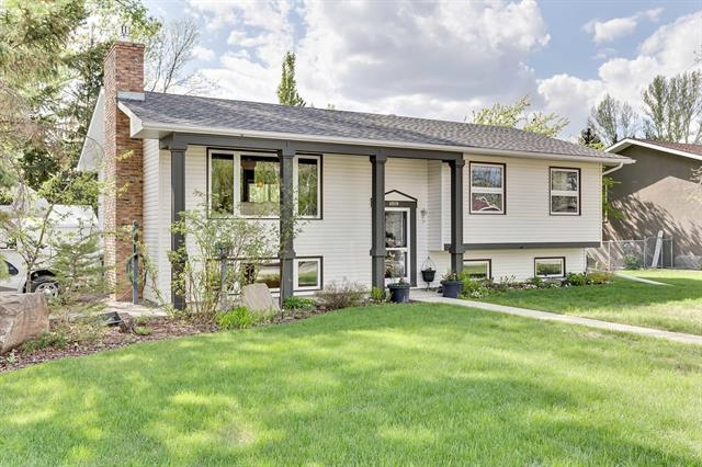West Side High River, is one of the most desirable neighborhoods; as is this beautiful 4 bedroom bilevel home you don't want to miss out on. This home nestles on 2.5 lots (75' x 125') Completely landscaped and full of perennials and mature trees. Upgraded from top to bottom. When you sit in the kitchen at the butcher block island it will feel cozy, warm and inviting. There are so many things to say about this home. GRANITE, QUARTZ, BUTCHER BLOCK ISLAND, MAPLE Custom Cabinetry, SOLID MAPLE Hardwood flooring, Every window IS VINYL, electric INSERT Fireplace w/SLATE stone wall...Just shy of 70k in RENOVATIONS...the list goes on and on. The Master bedroom has its own private door to the Main Bathroom. The basement is FULLY Developed, features an over sized FOURTH bedroom, living room, games area, storage room, extra large LAUNDRY ROOM and 3 piece bath. Definitely a MUST View. WEST FACING two tiered deck extends off the kitchen into the back yard GRAB a lounger and book, you won't want to leave! Enjoy