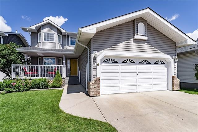 Incredible Value at $400,000! This one won't last long! Welcome to Edgewater Gardens Estates - A tranquil, fully developed area in the heart of Airdrie, with mature trees and large lots. Close to all amenities, parks, downtown, walking distance to schools & great access to the highway. Huge landscaped/fenced backyard-big enough to build a private skating rink! Relax and enjoy the lilac bushes on the south facing front porch of this move-in-ready 4 bed 3.5 bath home. Updated & renovated-professionally developed basement(city permits)& new siding/roof in 2014. Open concept kitchen/living area with gas fireplace & eating nook overlooking the back deck.Also on the main floor-formal dining area with stunning french doors opening onto a charming front living area with gorgeous hardwood floors.3 beds up include a master retreat with separate tub/shower. In the basement you'll find a media/rec area with a bed/bath and amazing soaker tub.Double attached garage has extra headroom & built in storage racks. Must see!