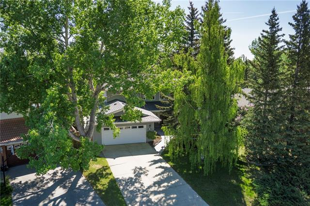 AMAZING PARK ON A PARK!!! HUGE 1218 sq m LOT w/GORGEOUS MATURE TREES + OVER 3864 sq ft DEVELOPED LIVING SPACE w/2+4 HEATED O-SIZED GARAGES + RV PARKING PAD! QUIET CUL-DE-SAC, HUGE WRAP-AROUND Patio, NEWER RUBBER ROOF, NEW FURNACE + 3 F/P! HUGE FOYER w/VAULTED Ceilings, BEAUTIFUL H/W FLOORS + STAIRS, Living rm w/doors to Patio, UPDATED Kitchen w/TONS of WALNUT CABINETRY, GRANITE counter tops, HUGE WINDOWS over sink, UNDER LIGHTING + PENDANT LIGHTS, Dining rm w/doors to Patio, BRICK 2-WAY WOOD FP, Family rm w/VAULTED CEILINGS + 2-STOREY WINDOWS, Office w/door to Sun rm, 2 pc bath, Laundry + Mud rm w/door to Patio. Upstairs feat. UNIQUE WALKWAY, H/W FLOORS THROUGHOUT, 4 pc Family bath w/linen closet + 3 Bdrm's incl. HUGE Master w/PRIVATE BALCONY, WOOD FP, 3 pc En-suite + W.I.C! Bsmt w/TONS of STORAGE incl FLEX rm, BIG Rec rm w/GAS FP, EXERCISE rm, 4th Bdrm w/door to 3pc Bath. GORGEOUS WELL-MAINTAINED B-yard w/TREES, HUGE Patio, 4-CAR HEATED GARAGE, RV PAD, PLAYHOUSE + BACKS ON PARK! BOOK YOUR SHOWING TODAY!