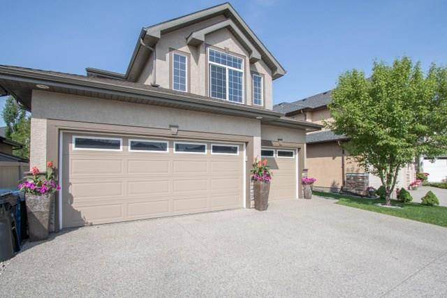 This turn key 3500 SQ FT Executive home is move in ready and PRICED TO SELL! This meticulously cared for home. Sunny West facing backyard on a quiet and safe cul de sac w/ easy access to both Deerfoot & Stoney Trail. Heated TRIPLE car garage w/ oversized driveway for ample parking. A/C. Upgrades(2017) throughout the home: newer hardwood flooring, carpet, designer paint, custom window coverings and lighting. Open kitchen w/ centre island and matching granite counter tops throughout the home that includes all bathrooms, S/S appliances (upgraded Fridge & Dishwasher 2017) and W/T Pantry. Upstairs features a large vaulted bonus room, 4 bedrooms including master ensuite w/ 5 piece bath, steam shower and walk in closet. The basement is professionally developed w/ wet bar, games room, pool table(incl) fifth bed or office. Backyard oasis w/ stamped concrete patio, gas hook up, Hot tub(incl) treed lot for privacy and plenty of room to entertain. This home won?t disappoint! Book your showing today. Quick Possession