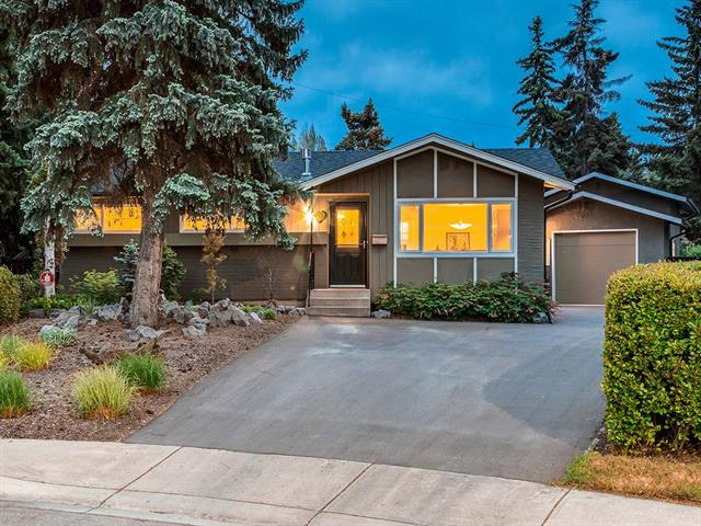 HAVE YOUR CAKE + EAT IT TOO!!! OVER 1914 sq ft of DEVELOPED LIVING SPACE on HUGE 864 sq m lot w/SPECTACULAR PROFESSIONAL LANDSCAPING in FRONT + BACK incl MATURE TREES + ROOM to build ADD'L O-SIZED GARAGE and/or RV PARKING! CLOSE to C-TRAIN, BUS, SHOPPING + MULTIPLE SCHOOLS! HEATED GARAGE + GREENHOUSE, NEW WINDOWS + ROOF, RE-PAVED DRIVEWAY, AMAZING UPDATES Throughout, H/W FLOORS + NEWER H/E FURNACE + H2O!  ENTER IN to BRIGHT Living rm w/LOVELY H/W, adj. Dining rm w/B-yard access, FULLY UPDATED Kitchen w/MODERN DARK Cabinetry, GORGEOUS B-Splash, GRANITE COUNTER TOPS, BIG WINDOWS over sink + STAINLESS STEEL appl incl GAS Counter top Stove + B/I OVEN, 3pc Family bath w/HUGE FRAME-LESS GLASS SHWR, 3 GOOD-SIZED Bdrm's incl LARGE MASTER w/DECK ACCESS! Bsmt w/KNOCKDOWN Ceilings, GAS FP, LARGE Bdrm + AMAZING 3pc Bath w/TRAVERTINE TILE + FIELD STONE! STUNNING SW-FACING B-yard feat EXTENDED Patio w/Hot Tub R/I, PROFESSIONALLY LANDSCAPED incl GORGEOUS POND, TREES + SHRUBS, PERFECT for ENTERTAINING.  A TRUE OASIS!!!
