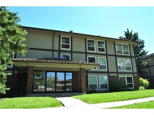 Great complex right next to fish creek park and full lake privileges. Please note that the building is a concrete building which is very rare in low rise apartment buildings. Recent new windows installed, as well as updated boilers for the building.  inside the unit you will find a spacious living room with a wood burning fire place that is a rarity in apartments these days.  great buy for investors or first time buyers. 2 very well sized bedrooms that are right across from the bathroom, with upgraded closet doors.  Updated white kitchen with matching appliances and a generous island in the middle, also plenty of space for a dining table. One of the few units in the complex with open kitchen dining room layout.  Of the living room you have access to the balcony for those nice summer barbecues.