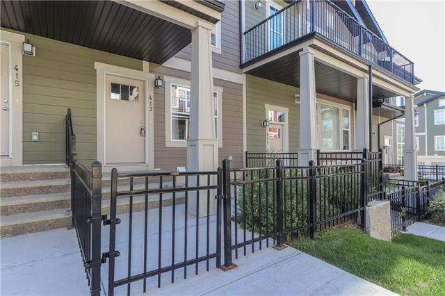 Welcome to this fabulous upgraded town home. Enjoy the gorgeous wide plank flooring that flows from the living room through the kitchen and hallway. You?ll love the upgraded kitchen with quartz counter tops, plenty of cupboards, pantry, island and neutral colors throughout. Enjoy open concept living room and 2 bedroom home comes complete with 4 pc bathroom with main floor laundry, a larger master with walk in closet along with a second bedroom, great for guests or extended family. Downstairs you will find an additional storage area and the double tandem attached garage that has plenty of room for two cars or 1 car and a ton of additional storage. Relax on your front fenced porch/yard or enjoy a BBQ with friends.