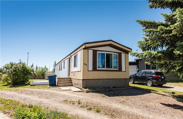 END OF SUMMER SPECIAL. This 922 square foot mobile home with two bedrooms & one Bath. One of the largest yards for you to enjoy.  (NO pad fees or Rent) this land is all yours!!  Backing onto a green space where you can play with the kids or the family dog. Location is key then this is the place for you.  The schools are nearby covering all age ranges.  The living room is nice an open offering room for a large sectional.  The front window overlooks the street and a large tree. The kitchen well organized with a dining nook. The first bedroom is very large offering space for storage, with the master bedroom at the back of the home. The laundry area is tucked out of the way just off the four-piece bathroom.  The yard boasts two sheds, firepit area and great space for a deck or perhaps an addition. A high easy walking score to shops, restaurants and more.  This yard is very large - with boundless ideas for a garden or perhaps a garage.  832 Spring Haven Court - make your move & CALL TODAY!!