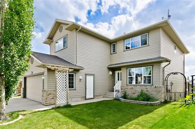 """GREAT VALUE IN CHESTERMERE!Come to view this stunning impeccably built centrally air conditioned 2 storey home in a desirable community """" THE COVE """". This house built in a quite cul-de sac  backing into green space leading you to the private beach.From the moment you walk into this home, you will notice the pride of ownership. The upgraded main floor consists of a Grand living room, a family room,office,dining room & Gourmet Kitchen. Gorgeous granite counter tops & maple cabinets grace the Kitchen  & include a good size central granite island/breakfast bar & stainless steel appliances.Check out the sun gleaming off the rich hardwood maple floors in the kitchen,living.family & dining rooms. You will love the sunny west facing back yard with wrap around deck,gas BBQ hookup,underground irrigation. Upstairs there are 4 spacious bedrooms, 4 pc bath & bonus room, highlighted by the beautiful master bedroom complete with a pristine 5 pc ensuite. The Home is absolutely amazing.Book your private showing today."""
