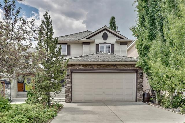 OPEN HOUSE: July 15th 12-2pm. Located on a quiet crescent, this two storey with nearly 2,800 square feet of living space gives you the chance to live in the prestigious community of Springbank Hill at under $300 per square foot! Main floor highlights include stone faced, gas fireplace in the living room, kitchen island with plenty of counter space, dining area off the kitchen & a den for a home office. Upstairs there is a common 4 piece bathroom, 3 bedrooms including the master featuring a walk-in closet & a 4 piece ensuite with a deep soaker tub and shower. The lower level has been professionally developed and features Huntwood custom cabinetry, a wet bar, laminate flooring, gas fireplace in the theatre room with Bose surround sound and safe & sound insulation in the walls and ceiling. The 4th bedroom has a private ensuite with heated tile floor & granite counter capping the vanity. The lot is beautifully landscaped with trees & perennials and offers a 2-tier deck in the sunny south facing back yard.