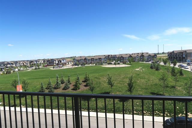 OPEN HOUSE SATURDAY OCT. 6; 1:00 to 3:30.TOP FLOOR UNIT with awesome view overlooking large park.Huge kitchen with many tall floor to ceiling darker stain cabinets,accented with granite counter tops.Large living room with sliding doors to LARGE wall to wall balcony over looking park.Double pocket doors to bedroom /flex room.FULL bathroom with Tile flooring and GRANITE counter top.EN-SUITE laundry with full size washer and dryer TILE flooring.Built-in work station.Stunning wide plank laminate Hardwood flooring.TITLED energized parking stall #90.EXTRA storage in underground parking  #191.Shows very well.LOWEST priced condo in the area.