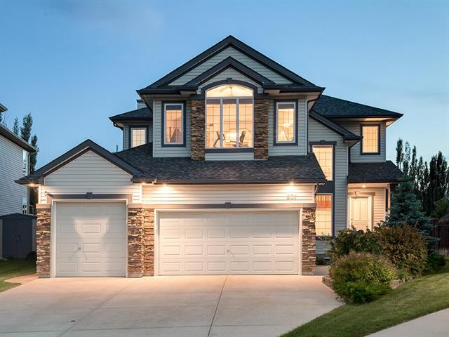 Over 3657 Sq.Ft. of development in this custom home located on one of Chestermere's LARGEST lots in a quiet cul-de-sac. Offering a huge TRIPLE garage, 2 A/C units, lake views & professionally landscaped pie shaped lot w/South exposure, fire pit area, underground sprinklers, garden, green house, massive composite deck & tons of mature trees offering absolute PRIVACY! Upon entering you are drawn to the 2 storey foyer & open floor plan. A large kitchen w/GRANITE counters, gas range, walk through pantry w/built in shelving & dining nook open to the open concept living area which is flooded w/natural light & offers views of the AMAZING backyard. An office, ½ bath & laundry area complete the main. Upstairs is a HUGE bonus rm w/LAKE VIEWS, 2 baths & 3 bedrooms including the KING sized master w/lavish 5 pce ensuite. The basement has been professionally finished w/4th bedroom, 3 pce bath, hobby rm & large living area with gorgeous wet bar area! Many new updates include new roof, furnaces, 2 sump pumps &water tank