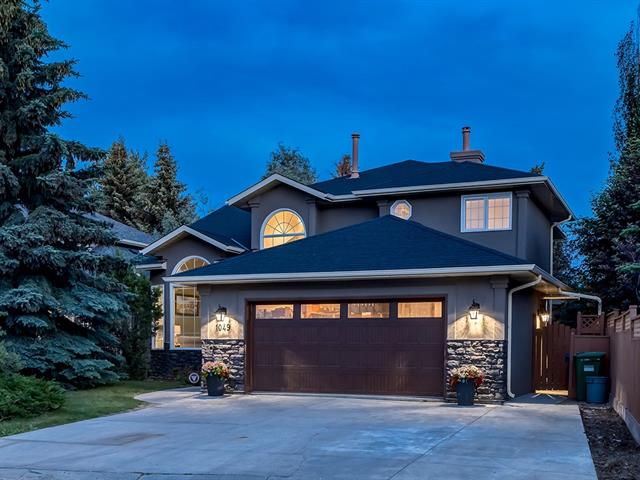 STUNNING HOME w/4325 sq ft of DEVELOPED LIVING SPACE + NEW ROOF, GARAGE DOOR, STONE/STUCCO EXTERIOR, TRIPLE PANE WINDOWS, 2 H2O tanks, H/E LIGHTING FIXTURES, ENGINEERED WOOD FLOORS, ZEBRA BLINDS in Bdrms, B/I CLOSET + GREAT FEATURES LIKE A/C, KNOCKDOWN Ceilings + HEATED O-SIZED Garage w/Dedicated Furnace! Entrance + Living rm w/VAULTED CEILINGS, 2pc Bath, Laundry/Mud rm, Office (possible Bdrm), LARGE Family rm w/FP, BEAUTIFUL Kitchen incl GORGEOUS CUSTOM CABINETS w/soft close drawers/doors, MARBLE b-splash, Quartz counter tops + ISLAND + S.S. appl incl B/I OVEN + COUNTER GAS STOVE, B-fast nook w/WINDOWS + DECK ACCESS + add'l Dining rm! Upstairs feat 5 pc Bath w/STAND UP SHWR, TUB + SKYLIGHT, 3 Bdrm's incl 1 w/W.I.C + AMAZING Master w/2 W.I.C's, 5 pc en-suite w/STAND UP SHWR + MASSAGE JETS, SOAKER TUB + PRIVATE BALCONY. Bsmt w/HUGE Rec rm + WET BAR, 3 pc Bath incl STAND UP SHWR + MASSAGE JETS + 2 LARGE Bdrm's w/W.I.C's! SOUTH-FACING B-YARD w/HUGE LUXURIOUS DECK + TREES + BACKS ONTO GREEN SPACE! ONE TO SEE!
