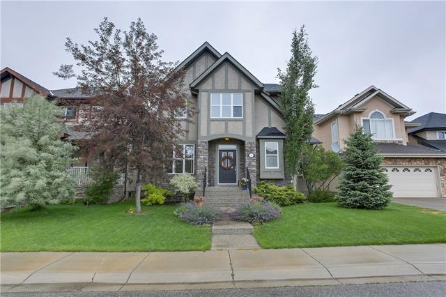 *Open House Sunday July 15th: 1-4 pm* Welcome to 127 Wentworth Manor, a beautiful original- owner home on a quiet street with private back yard and paved back alley access.  Lovely main floor includes office with built in cabinetry, dining room with walk- through butlers pantry, and generous sized family room with built-in cabinetry and speakers.  Kitchen boasts stainless steel appliances, granite countertops, and mud room with ample natural light/large windows.  The double detached garage in the private back yard with two poured concrete patios, speakers and mature trees/greenery is a summer dream! Upstairs features three bedrooms, generous sized 5 piece ensuite with 2 sinks, and separate toilet/shower. Basement features two large bedrooms and huge family room, built in speakers, and rough-in for bathroom.  All within walking distance to city transit and public/Catholic elementary & jr. high schools. Pride of ownership is evident in this home - call for your private viewing
