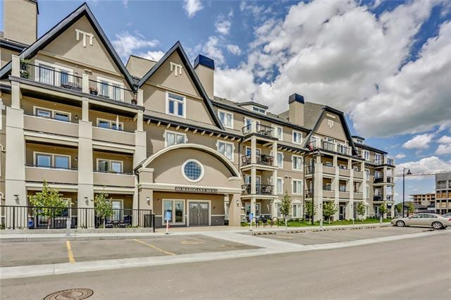 """Lakeside living at its finest! Sandgate has been expertly designed to be rich in character, design and livability, both inside your home and outside. This TOP FLOOR 2 bedroom unit built by Multi-Family Builder of the Year includes UNDERGROUND PARKING & VIEWS FROM THE BALCONY OVERLOOKING DOWNTOWN AND THE MOUNTAINS. This unit offers 1 1/4"""" Quartz counters in the kitchen and bath, 42"""" tall """"Meringue"""" cabinets, a full stainless steel Whirlpool appliance package, 10' knockdown ceilings, spacious balcony complete with a barbecue gas line! Open design kitchen, central dining area and back lifestyle room. Second bedroom off the entry and the main 4pc bath offers a cheater door from the master bedrooms walk through closet. Why rent when you can own and live in Calgary's top community. 22km of pathways, 2 beaches, a plethora of commercial amenities, green space, playgrounds, pets welcome, a fitness studio, lending library and guest suite. Not just a home, a smart investment and generous lifestyle."""