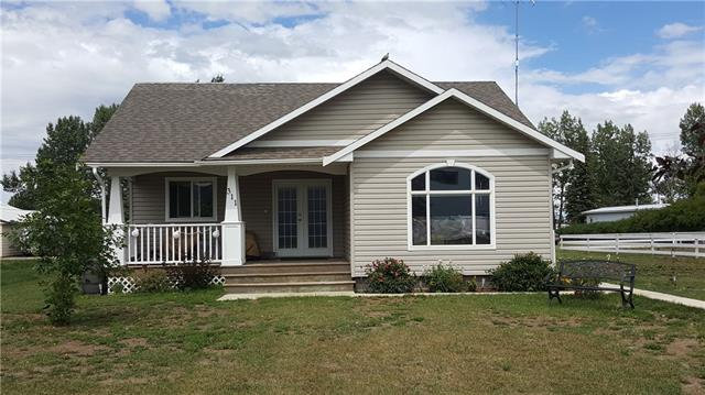 Looking for the quiet small town lifestyle, while being not too far from the city?  If so, you may want to check this out!  This bungalow, built in 2011, is in the Village of Carmangay, Alberta, along Highway #23, just 62 km north of the City of Lethbridge.  This open concept bungalow features a living room, kitchen and dining area on the main floor.  Also on the main level are the master bedroom with two piece ensuite bathroom and closet organizer, full bathroom with low flow toilet, and second bedroom.  The basement is fully developed with another bedroom, L-shaped family room, utility room, laundry room and theatre room.  The family room has a shuffle board, which is included in the sale of this property.  In the theatre room, there is a projection TV, which is negotiable with the sale.  Extra boxes of flooring in the basement are included as well.  Kitchen appliances are newer.  The furnace is a high efficient model.  Water softener is rented, and so is the alarm system.